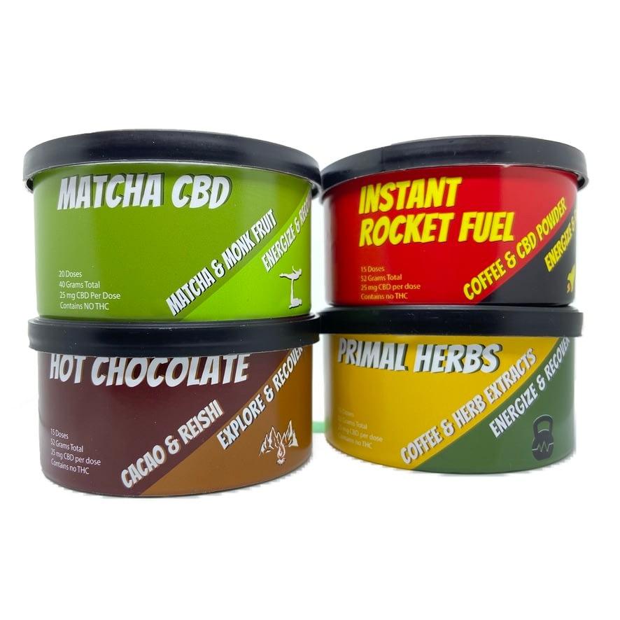 Rise and grind CBD tin cans that contain cbd matcha, cbd, coffee, cbd primal herbs and cbd hot chocolate